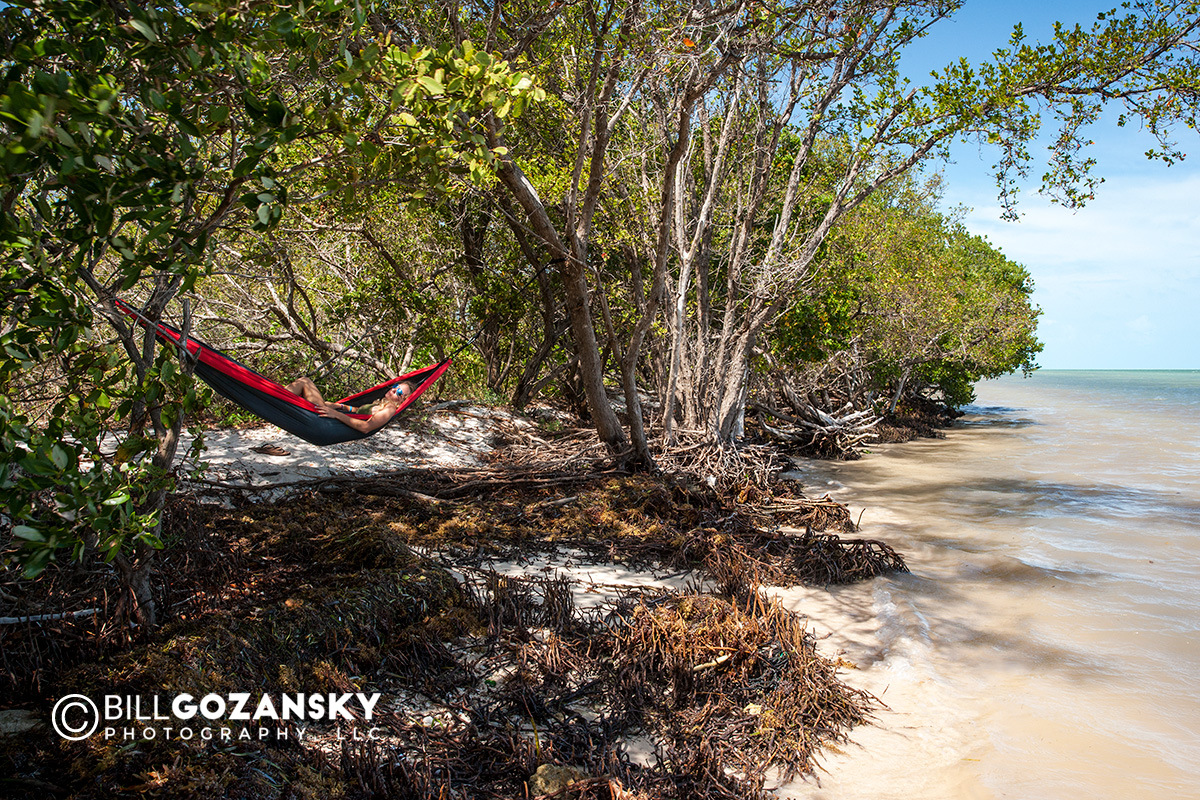 Young woman in hammock at Coco Plum Beach - Marathon Key, Florida, USA