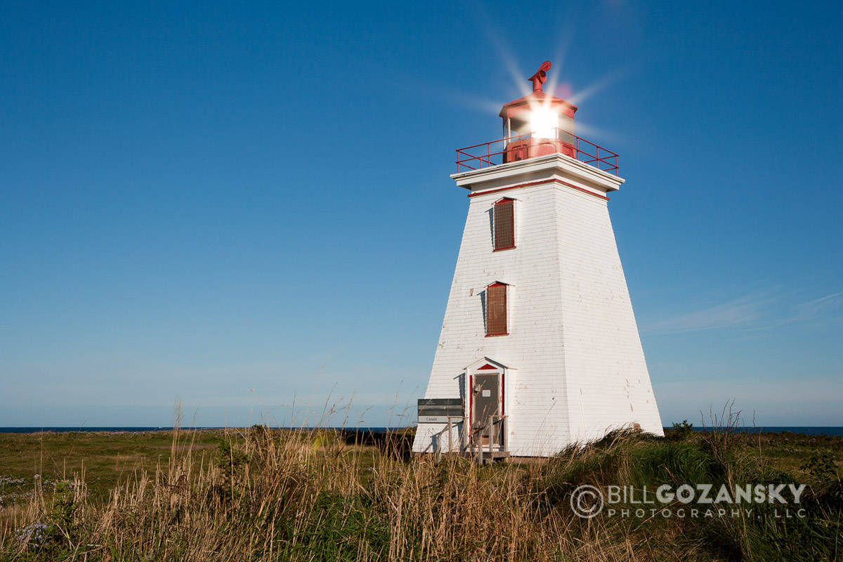 Sun reflection in Cape Egmont Lighthouse - Cape Egmont, Prince Edward Island, Canada