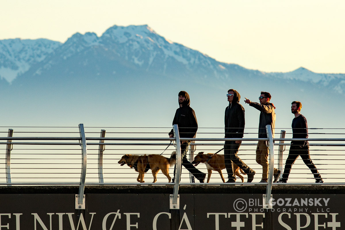 People walking on Breakwater at Ogden Point - Victoria, Vancouver Island, British Columbia, Canada